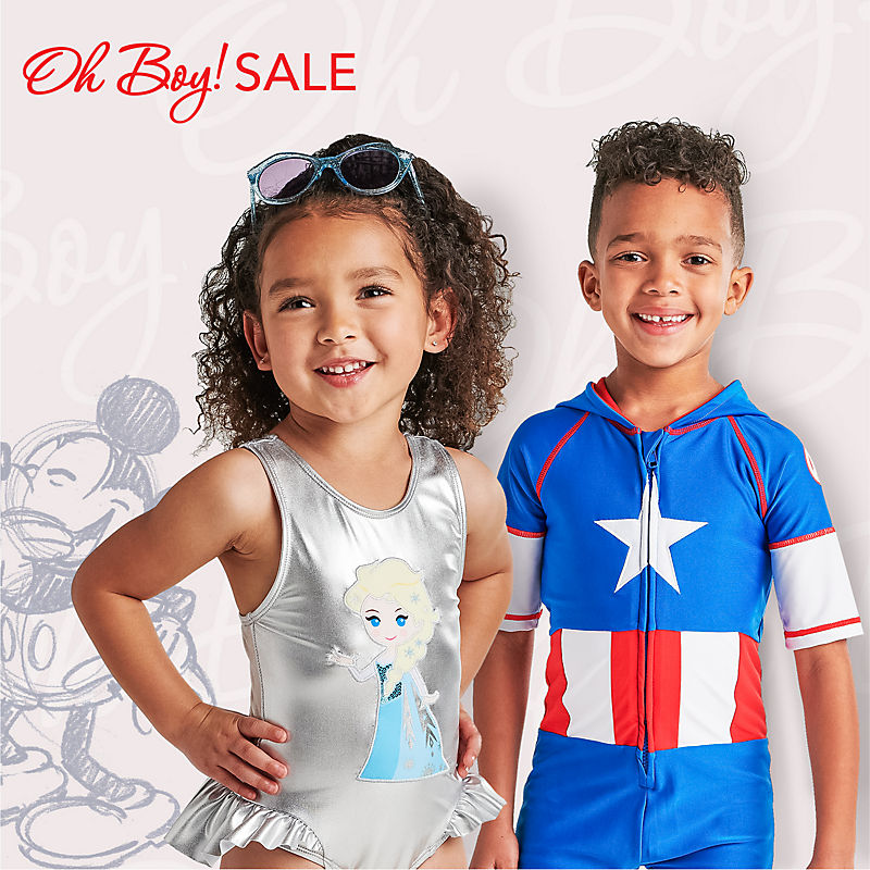 Girl in Elsa swimsuit and boy in Captain America swimwear