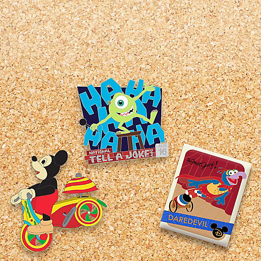 "pin featuring Mickey Mouse on a scooter, Mike Wazowski with a microphone and says ""ha ha ha! National Tell a Joke Day August 16"", and The Great Gonzo shooting out of a cannon"