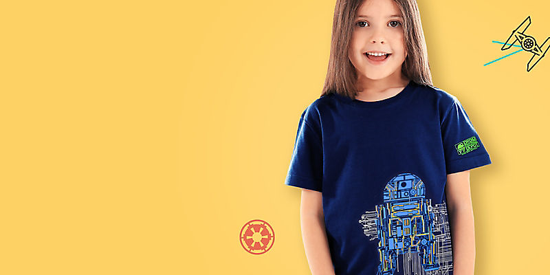 girl wearing t-shirt featuring droids from Batuu