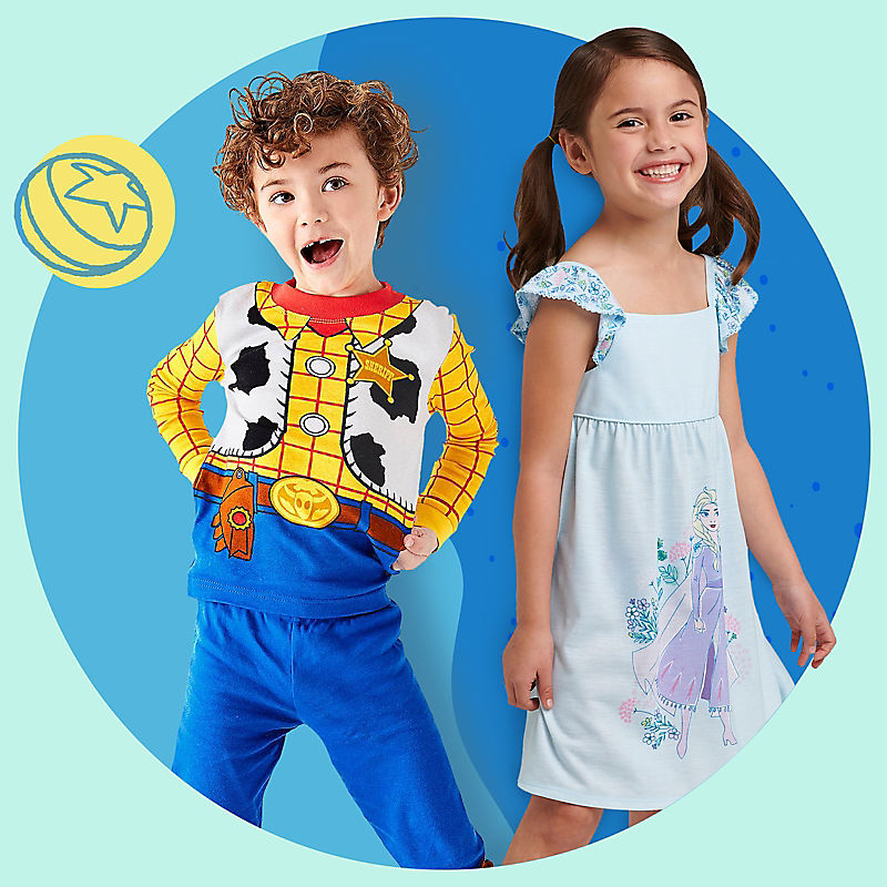 Boy in Woody pajamas and girl in Elsa nightgown