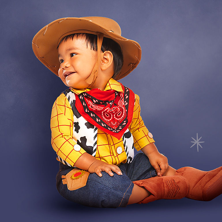 Baby in Woody costume