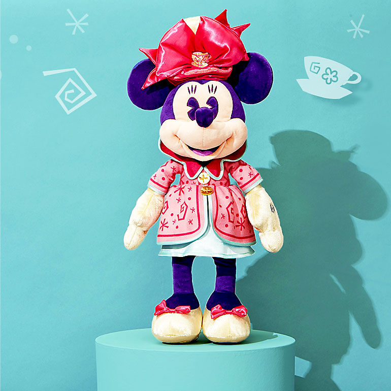 Minnie plush with Mad Tea Party design