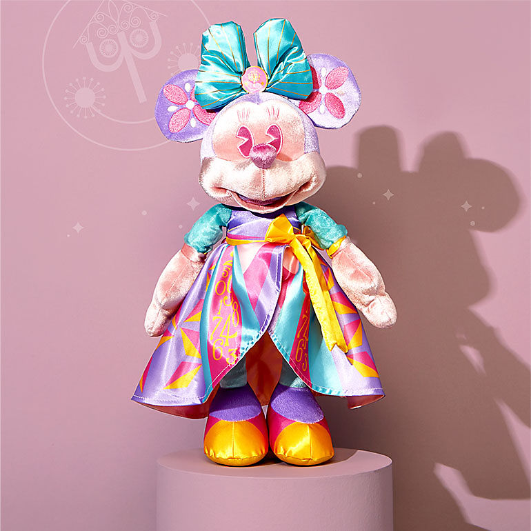 Minnie plush with it's a small world design