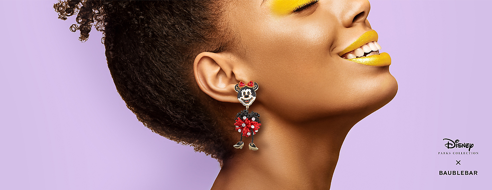 Woman wearing Minnie Mouse earrings