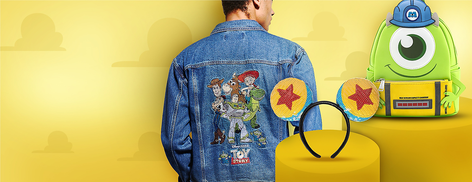 Man in Toy Story denim jacket Pixar cap Mike Wazowski backpack