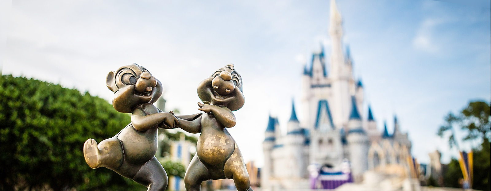 Chip and Dale bronze sculpt with Cinderella Castle in the background