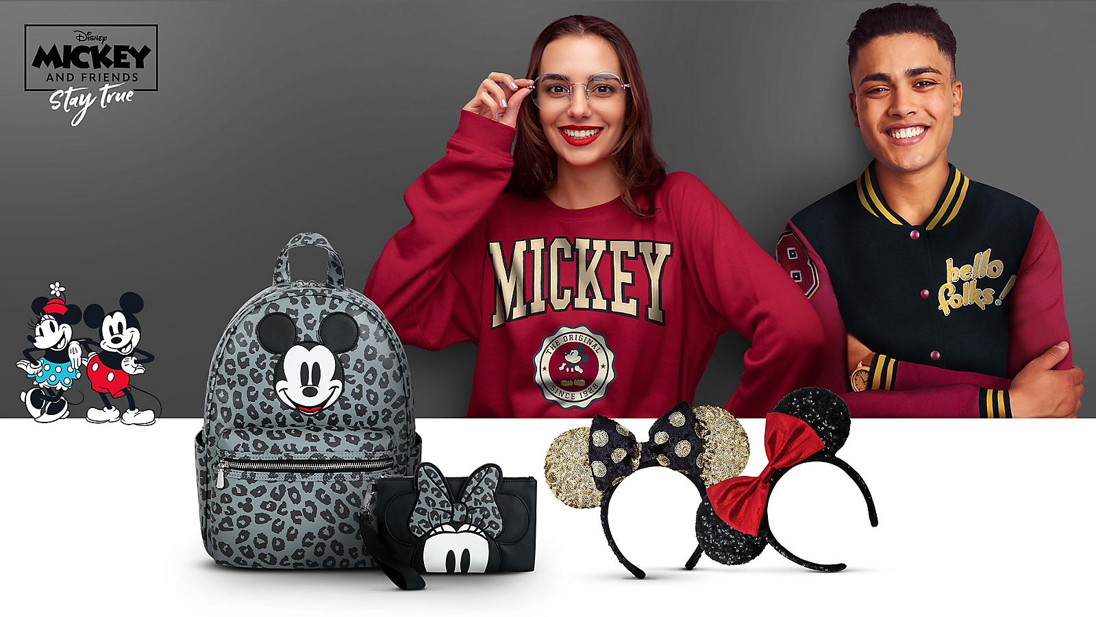 Woman in Mickey Mouse sweatshirt Man in Mickey Mouse varsity jacket Mickey Mouse leopard print backpack Minnie Mouse leopard print wallet Sequined Minnie Mouse ear headbands